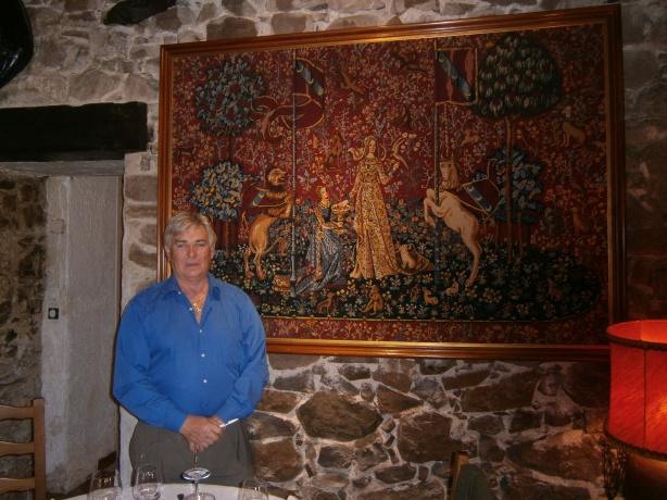 The owner in front of a tapestry he had worked himself